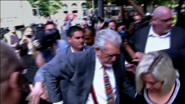 rolf harris begins appeal against his sentence for indecent assualts 472014 / t04071401 southwark crown court ext rolf harris from car with his... - bindi stock videos and b-roll footage