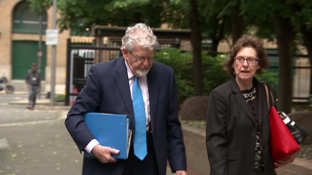 rolf harris cleared of sexual assault charges england london crown court southwark ext rolf harris from car and along to court - rolf harris stock videos and b-roll footage