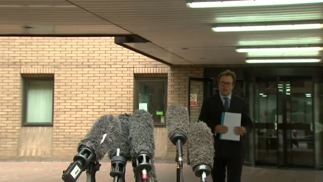 rolf harris cleared of sexual assault charges lawyer statement england london southwark crown court ext daniel berke reading statement to press sot - rolf harris stock videos and b-roll footage