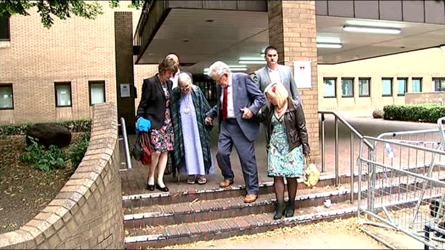 london ext rolf harris leaving court building with wife wife alwen hughes and daughter bindi / descending steps of court / harris and family getting... - bindi stock videos and b-roll footage