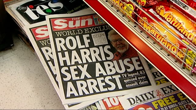 rolf harris named as entertainer arrested over sex abuse allegations london copies of the sun newspaper headlined with the story about the arrest of... - rolf harris stock videos and b-roll footage
