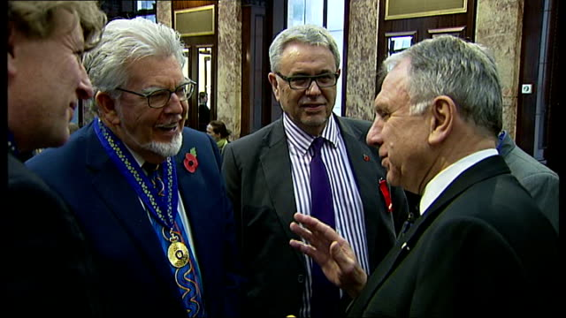 rolf harris named as entertainer arrested over sex abuse allegations r07111203 rolf harris talking with people after he was appointed an officer of... - rolf harris stock videos and b-roll footage