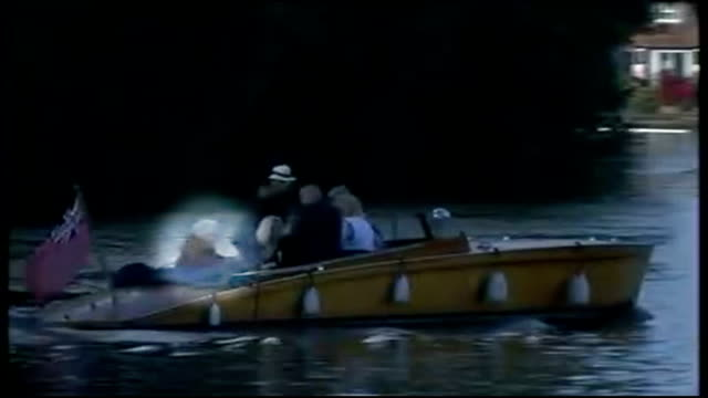 rolf harris sentenced to 5 years and 9 months england berkshire bray ext long shot of rolf harris seated in back of motor boat on river thames... - rolf harris stock videos and b-roll footage