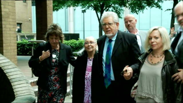 alleged victim gives evidence ext rolf harris alwen and bindi leaving court - bindi stock videos and b-roll footage