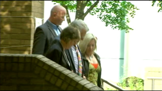harris leaves court england london ext rolf harris leaving court with daughter bindi and others along and into car - bindi stock videos and b-roll footage