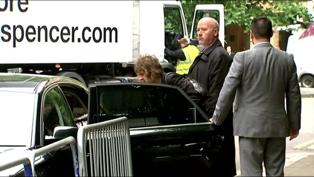 rolf harris sexual assault trial continues court arrivals england london southwark ext car arriving / entertainer rolf harris out of car with wife... - bindi stock videos and b-roll footage