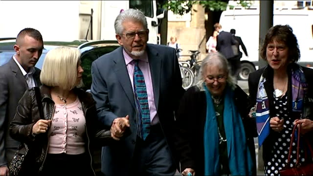 court arrival england london southwark crown court ext rolf harris from car and along and into court with wife alwen hughes and daughter bindi harris... - rolf harris stock videos and b-roll footage