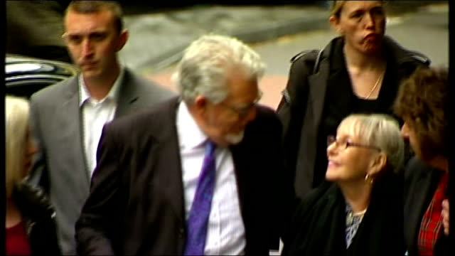 rolf harris gives evidence england london southwark crown court photography *** rolf harris along towards court with wife alwen hughes and daughter... - body adornment stock videos and b-roll footage