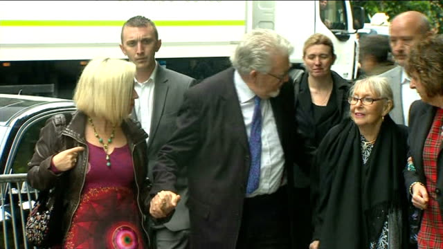 rolf harris gives evidence england london southwark ext rolf harris arriving at southwark crown court with his wife alwen and daughter bindi reporter... - body adornment stock videos and b-roll footage