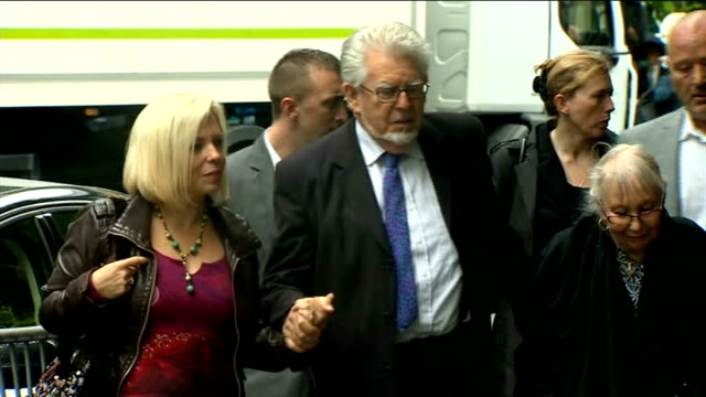 rolf harris gives evidence england london southwark crown court photography *** rolf harris along towards court with his wife alwen hughes and... - bindi stock videos and b-roll footage