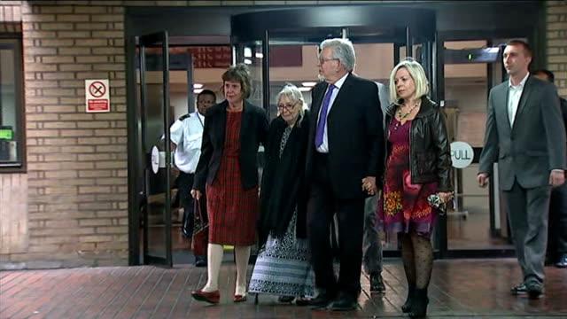 rolf harris gives evidence rolf harris from court and along as holding hands with his wife alwen hughes and daughter bindi - rolf harris stock videos and b-roll footage