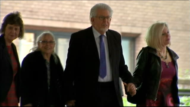 rolf harris gives evidence ****some various of harris his wife alwen daughter bindi and others away from court - body adornment stock videos and b-roll footage