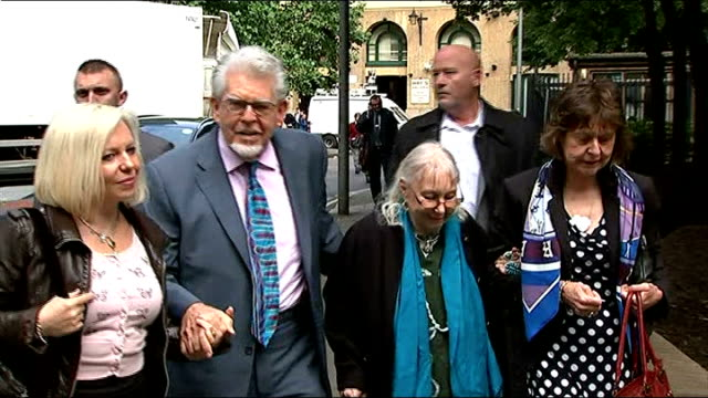 video evidence played in court england london southwark photography*** rolf harris along to court holding hands with his wife alwen and daughter bindi - rolf harris stock videos and b-roll footage