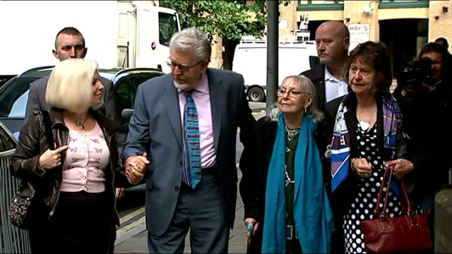 video evidence played in court london southwark crown court ext rolf harris wife alwen and daughter bindi nicholls arriving at court reporter to... - rolf harris stock videos and b-roll footage