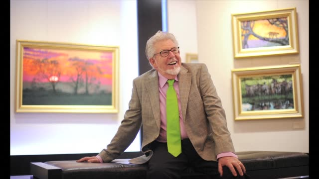 rolf harris the australian artist and entertainer has been charged with nine counts of indecent assault on two girls aged under 16 prosecutors in... - rolf harris stock videos and b-roll footage
