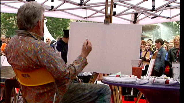 harris described as 'jekyll and hyde' character r13100401 / trafalgar square ext rolf harris painting at an easel in a marquee - rolf harris stock videos and b-roll footage