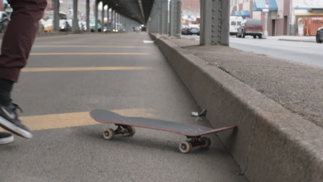 B Roll of a young, mixed race man skateboarding