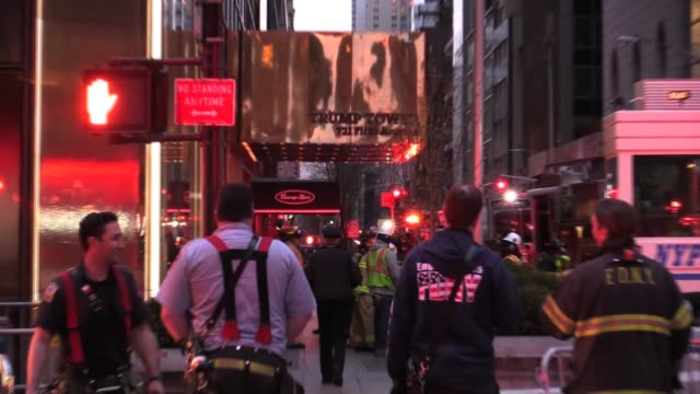 vídeos de stock, filmes e b-roll de b roll of fire trucks in front of trump tower shots of building pan down - b roll