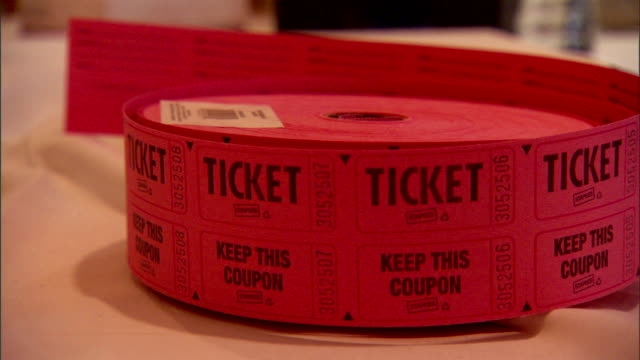 roll of pink tickets reading ticket & keep this coupon. coupons, ticketing, admission, raffle, concessions, admit one, attraction, event. - raffles city stock videos & royalty-free footage