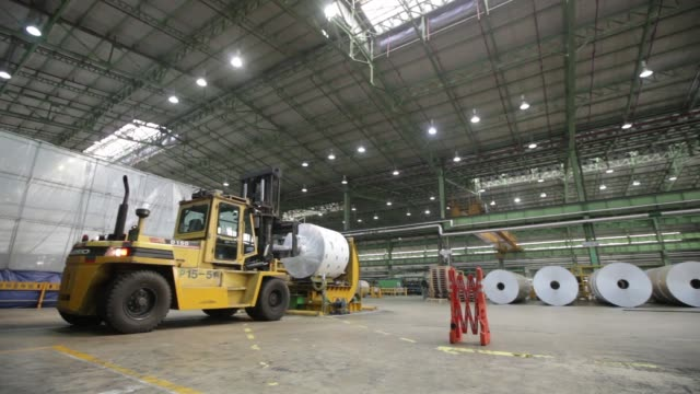 A roll of sheet aluminum is moved by a crane after cold rolling at the Novelis Inc production facility in Yeongju A roll of sheet aluminum passes...