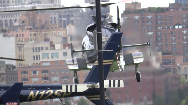 vidéos et rushes de roll of the scene at pier a park with the take off of an official helicopter and the outside of the hoboken path station. footage of hoboken police... - b roll
