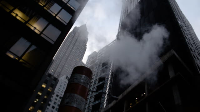 B roll shot looking up at New York City skyscrapers on a cold afternoon