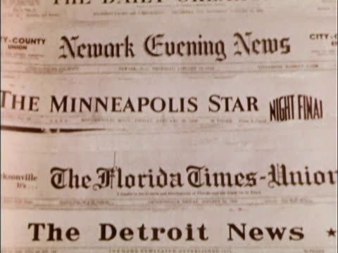 1956 cu ds. roll through mastheads of several newspapers from january 1956 / usa - dolly shot stock videos & royalty-free footage