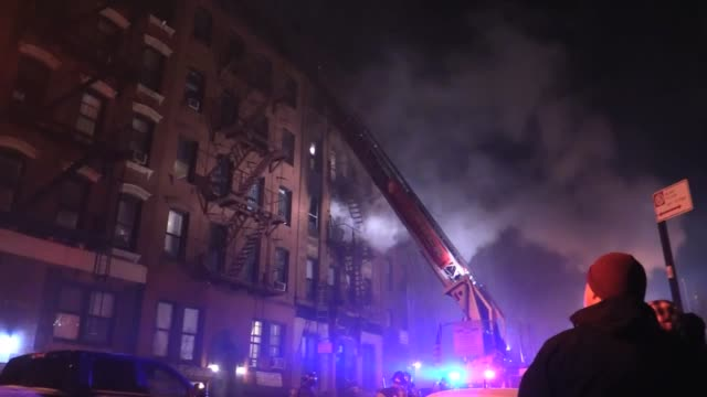 B Roll Two alarm apartment fire one injury 3rd street between 1rst and 2nd Ave East Village NYC one injury on stretcher