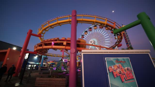 roller coaster at santa monica pier - santa monica pier sign stock videos & royalty-free footage