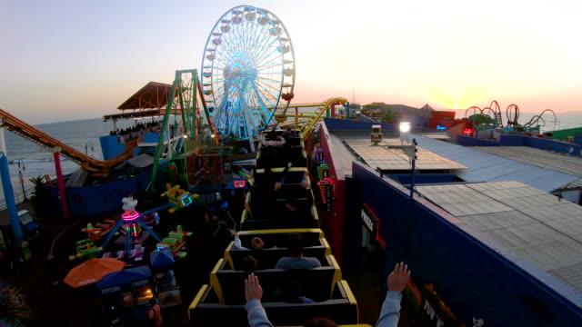roller coaster at santa monica pier - big wheel stock videos & royalty-free footage