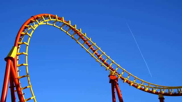 roller coaster in front of blue sky, prater, vienna, vienna, austria, europe - rollercoaster stock videos & royalty-free footage