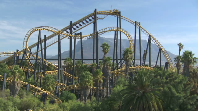 ws roller coaster in theme park / western cape, south africa - rollercoaster stock videos & royalty-free footage