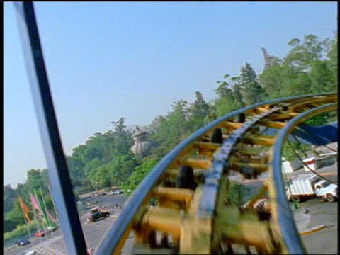 roller coaster point of view down steep hill, around curves + up + down hills - rollercoaster stock videos & royalty-free footage
