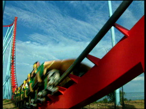 Roller coaster races around ride including loop the loop as passengers are enthralled with excitement Salou