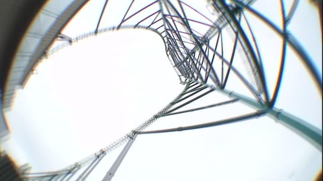 a roller coaster tower spins overhead. - 目が回る点の映像素材/bロール