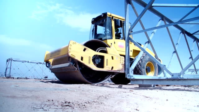 roller compactor at  construction site - construction vehicle stock videos and b-roll footage