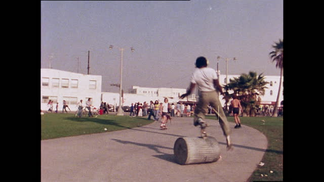 roller skaters and cyclist attempt to jump hurdle, venice beach; 1978 - blooper film clip stock videos & royalty-free footage