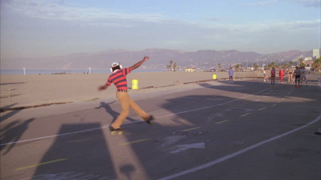 ms pan roller skaters and people riding bicycles on boardwalk beach / santa monica, california, united states - santa monica california stock videos & royalty-free footage