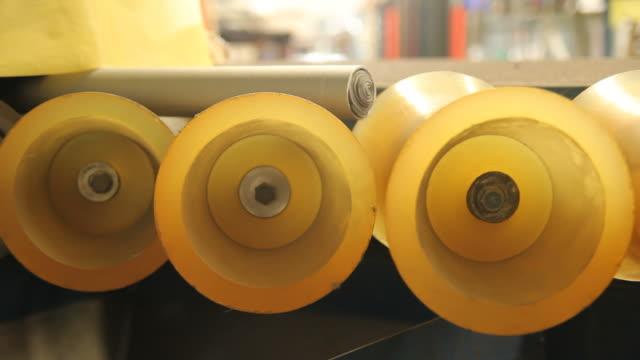stockvideo's en b-roll-footage met roller transport an iron core to shot blasting machine - rubber