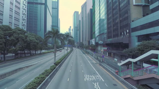 Rollerblader skates on empty road in downtown Hong Hong