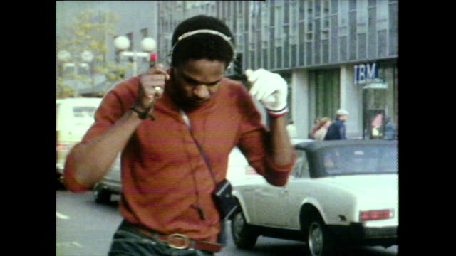 rollerbladers dancing on skates with portable stereos; 1981 - bbc archive stock-videos und b-roll-filmmaterial