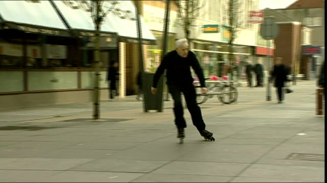 stockvideo's en b-roll-footage met rollerblading pensioner found guilty of endangering the public england merseyside southport chapel street ext geoff dornan rollerblading in street - southport engeland