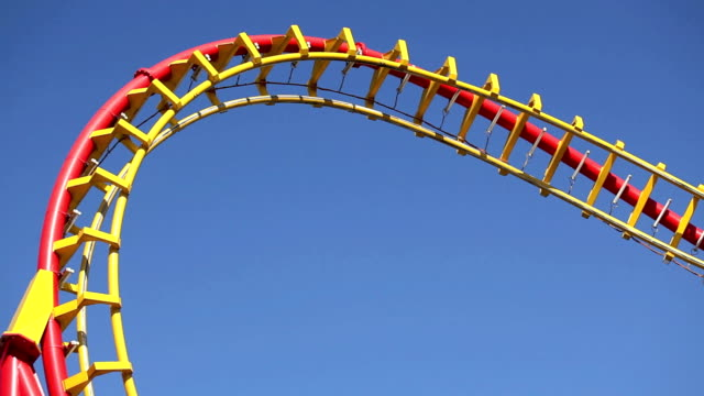 rollercoaster against blue sky - rollercoaster stock videos & royalty-free footage
