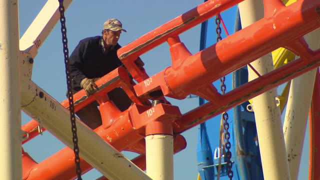 rollercoaster is building up - crane construction machinery stock videos & royalty-free footage