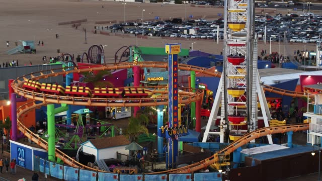 rollercoaster on the santa monica pier - aerial - vergnügungspark stock-videos und b-roll-filmmaterial
