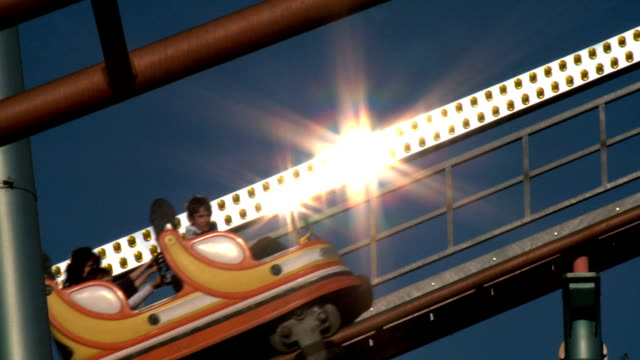 rollercoaster passing by, reflections, slow-motion - prater park stock videos & royalty-free footage