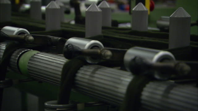 rollers pull coiled fabric in a textile mill. - textile mill stock videos & royalty-free footage