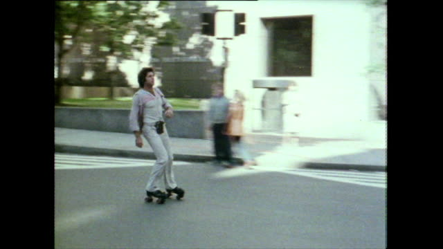 vidéos et rushes de rollerskater speeds past dancing on skates; boston, 1981 - style rétro