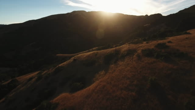 rolling california hills at sunset, wide aerial - hill stock videos & royalty-free footage