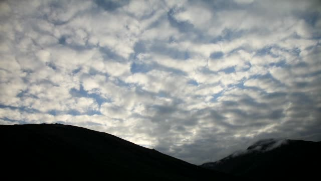 rolling clouds and silhouetted hills. - arctic national wildlife refuge stock videos & royalty-free footage